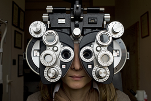 Optometrist diopter with girl.