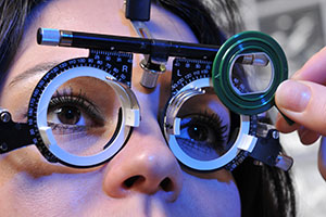 A series of eye exam related pictures of a beautiful patient.